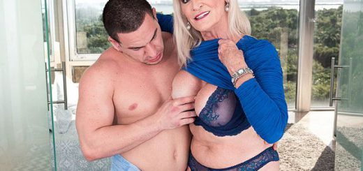 64-year-old Leah fucks a 23-year-old In this video, 64-year-old wife and granny Leah L'Amour has sex in the sauna and the bedroom with 23-year-old Peter Green. She sucks and jacks his cock. She has him fuck her every which way. He cums on her pretty fa...